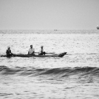 Fishermen on a wooden catamaran ride, Marina Beach, Bay of Bengal, Chennai, India