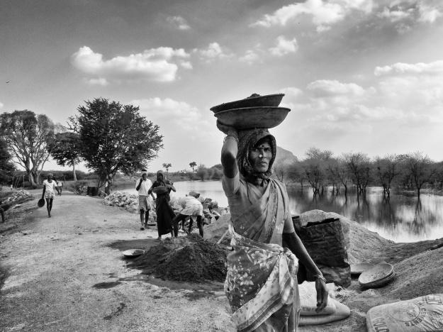 A woman construction worker at the road works, T.Kallupatti, Tamil Nadu, India.