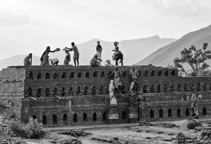 Workers, both men and women, working in a brick kiln, Near T. Kallupatti, Tamil Nadu, India.