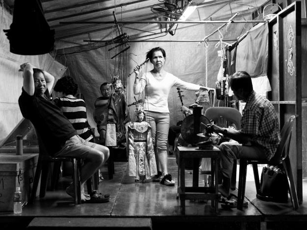 Puppeteer, musicians and the backstage crew are getting ready for the next scene. Hougang, Singapore