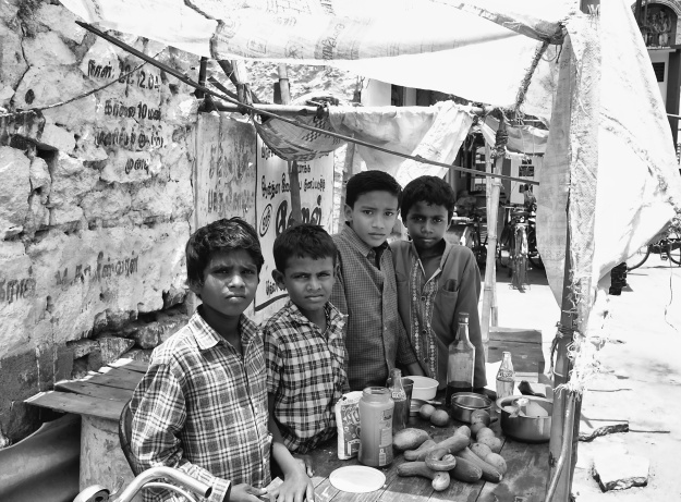 Kids setup a petty shop to sell cucumber and cool drinks in their summer holidays; the money they hoped to pay for their school fees. Virudhunagar, India.