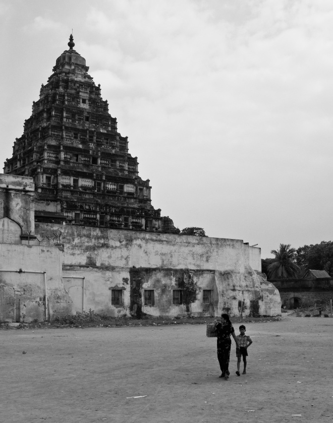 A mother and son walking behind the Tanjore old palace. Tanjore, Tamil Nadu, India
