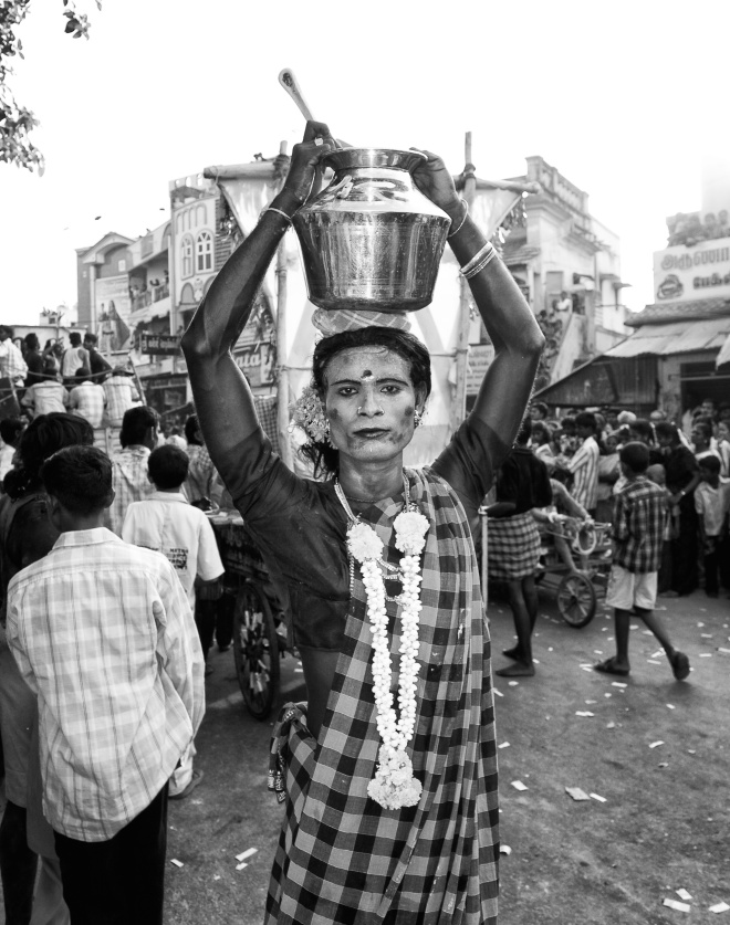 An young man cast as a woman selling buttermilk, for the temple festival procession. T.Kallupatti, Tamil Nadu, India