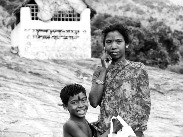 A mother of a tribe living in hills with her son, Thannipaari, Sathuragiri Hills, Tamil Nadu, India