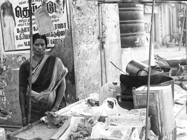 A woman at her mobile food-stall. Madurai, India