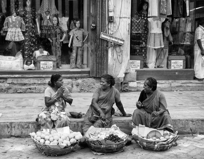 Street vendors, having an animated chat. Madurai, Tamil Nadu, India