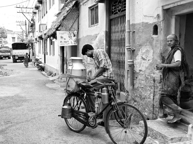 Milkman selling milk to households, Virudhunagar, Tamil Nadu, India