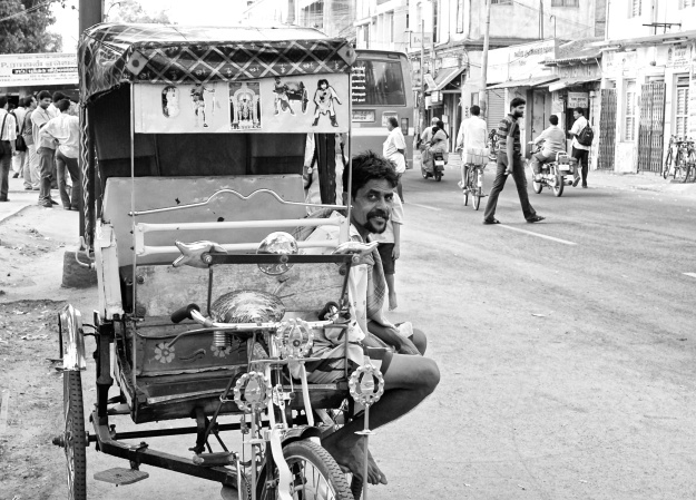 Rickshaw man on the road. Madurai, India
