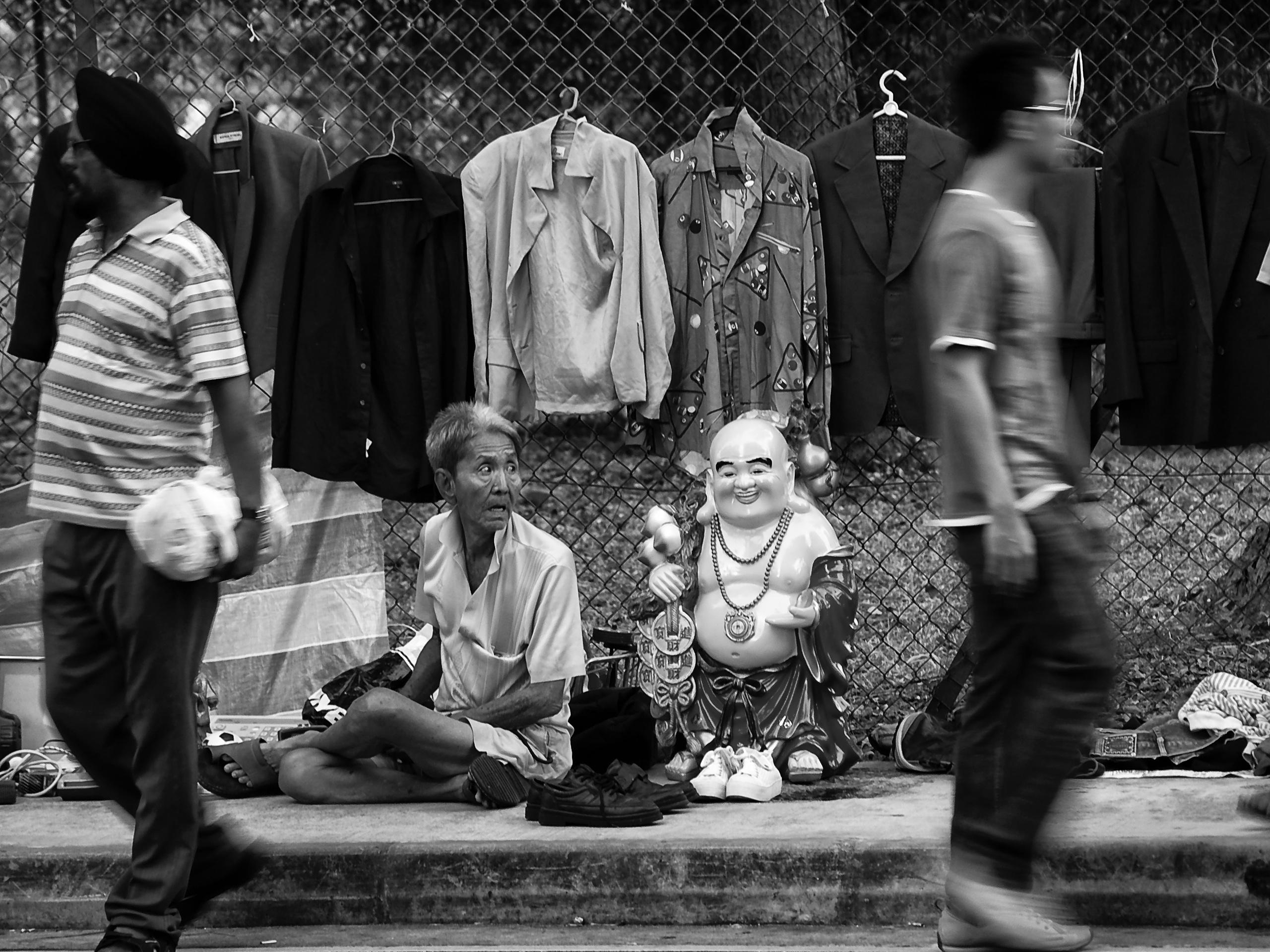 Beside the laughing Buddha, a street scene at Jln Besar market, Singapore