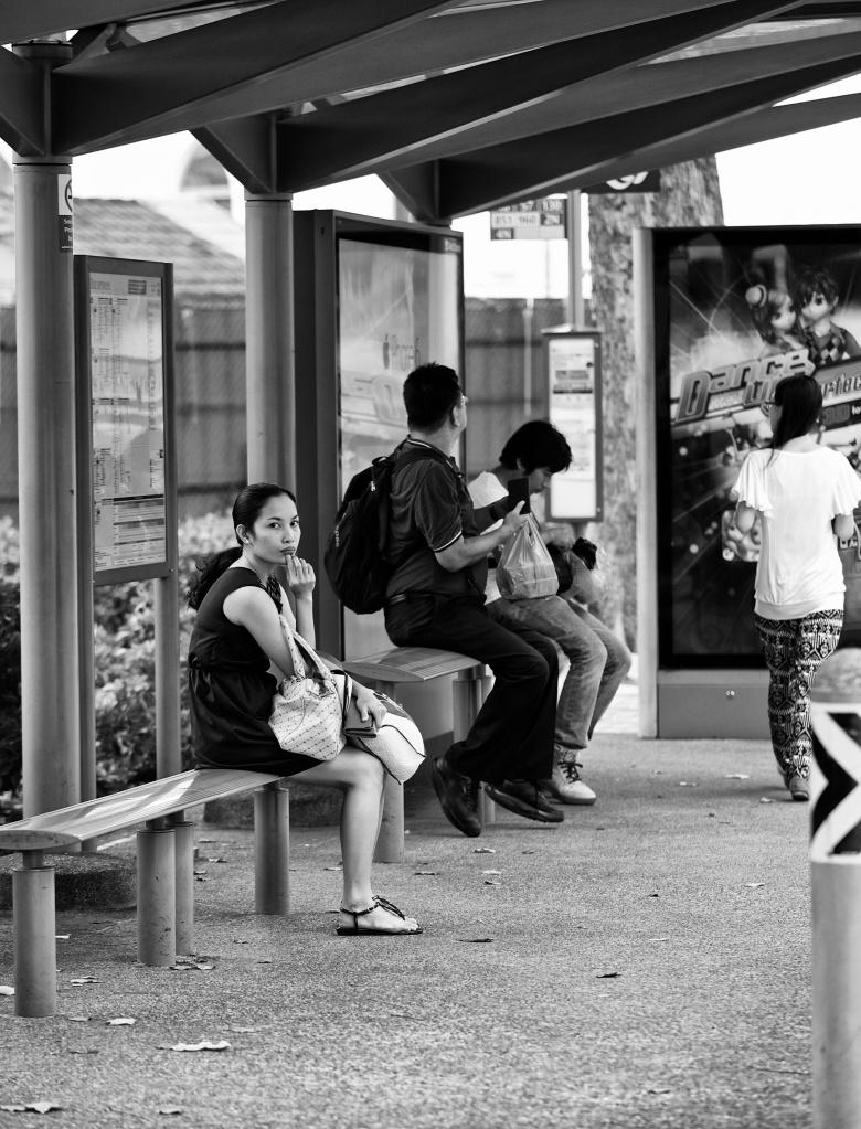 Awaiting at a bus stop, Bugis, Singapore