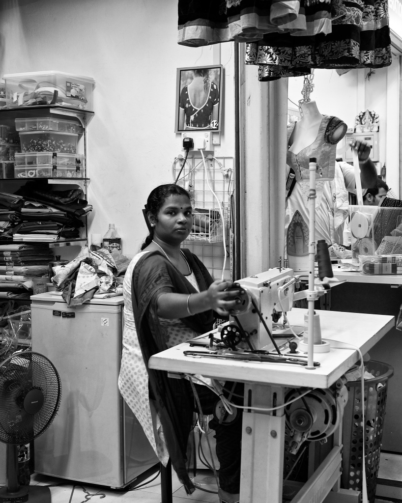 A woman tailor at work, Tekka Market, Little India, Singapore