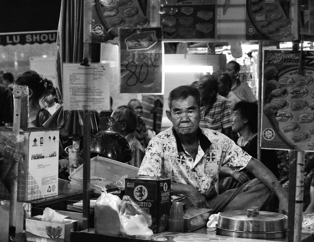 An ice cream seller in his mobile cart setup, Bugis Street, Singapore