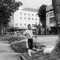 A Chinese migrant sweeper at work, PayaLebar, Singapore