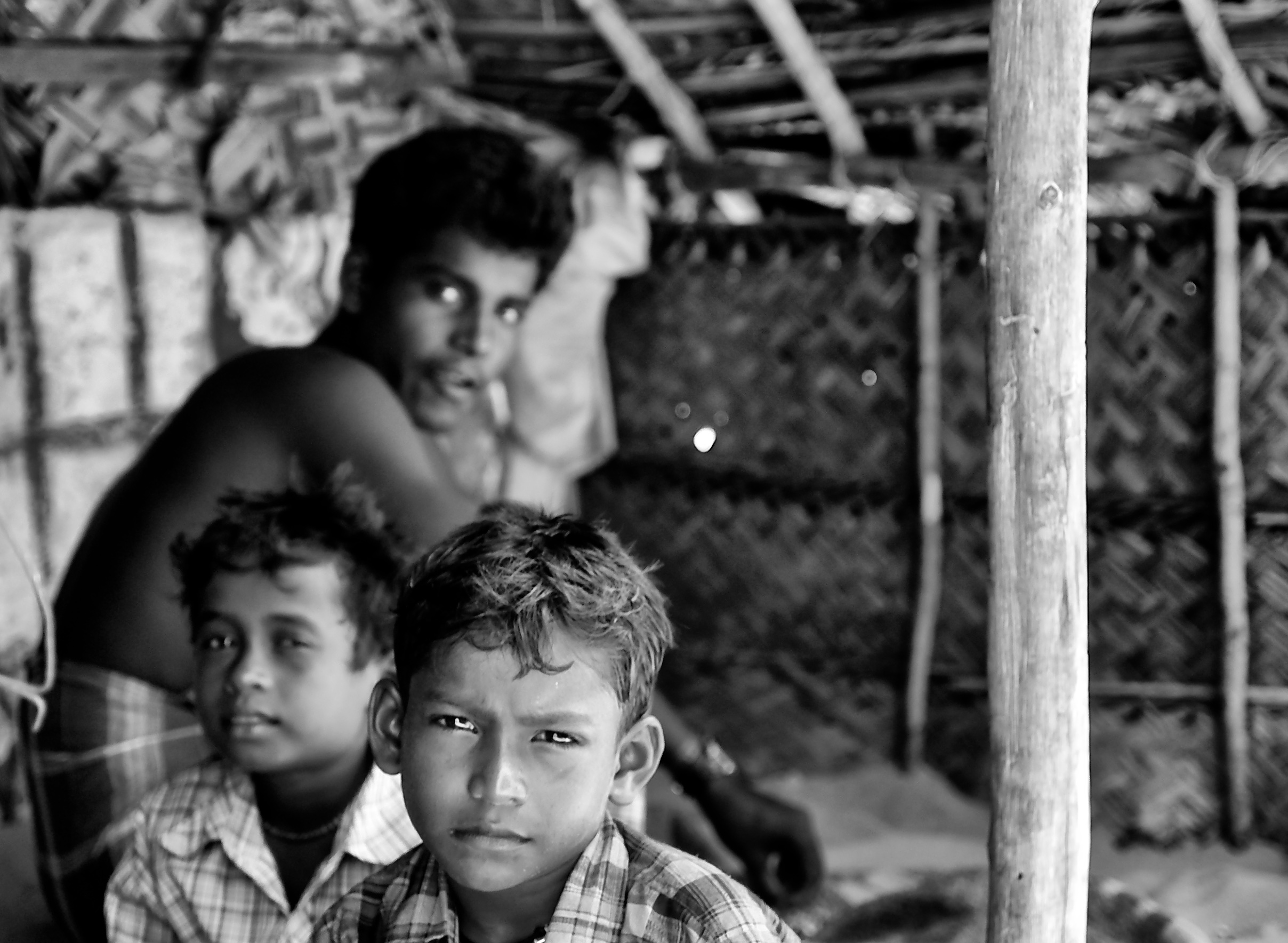 Young boys inside the fishermen's hut, Dhanuskodi, Tamil Nadu, India