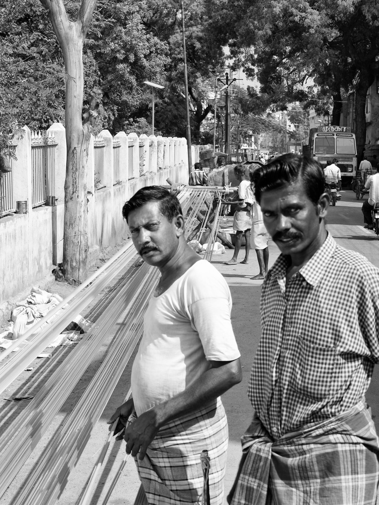 Rope-makers threading and dyeing by the roadside. Madurai, India