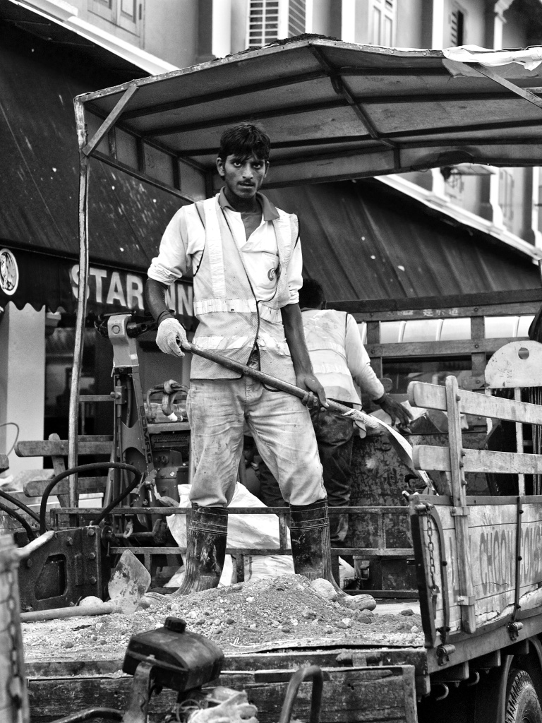 One migrant construction worker at work in his truck, Kampong Kapor Road, Singapore