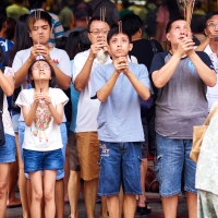 Worshippers at Kwan Im Thong Hood Cho Temple, Bugis, Singapore