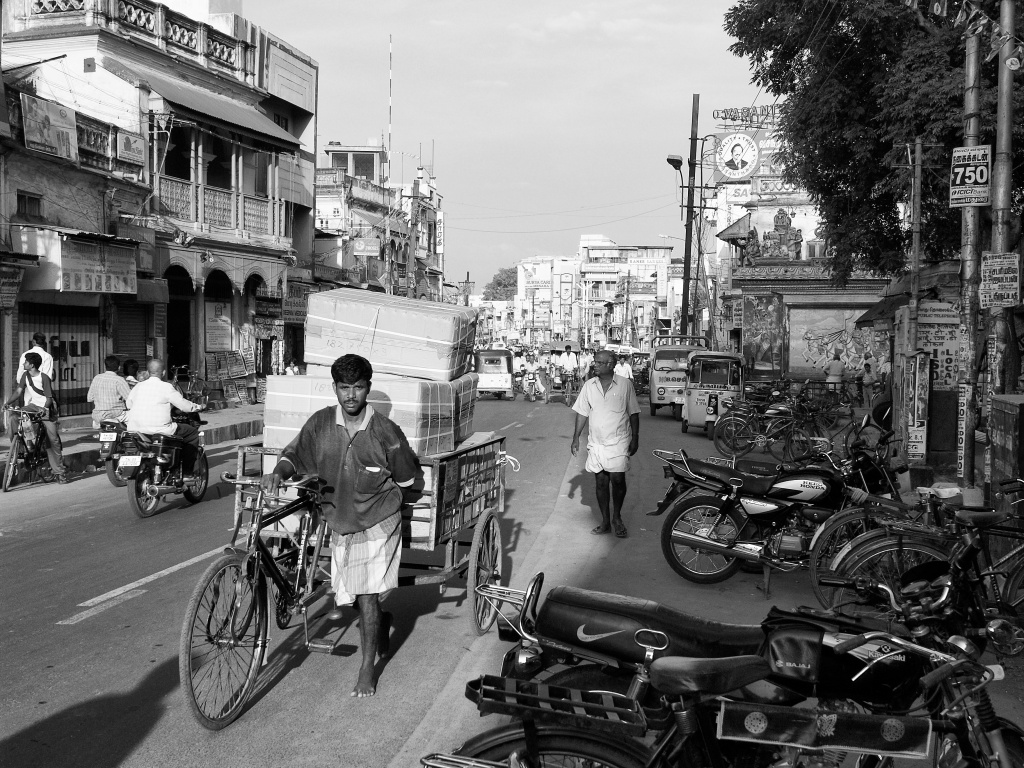 A worker transporting goods in his tricycle. Madurai, Tamil Nadu, India