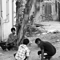 Kids playing marbles in the street side, Virudhunagar, Tamil Nadu, India
