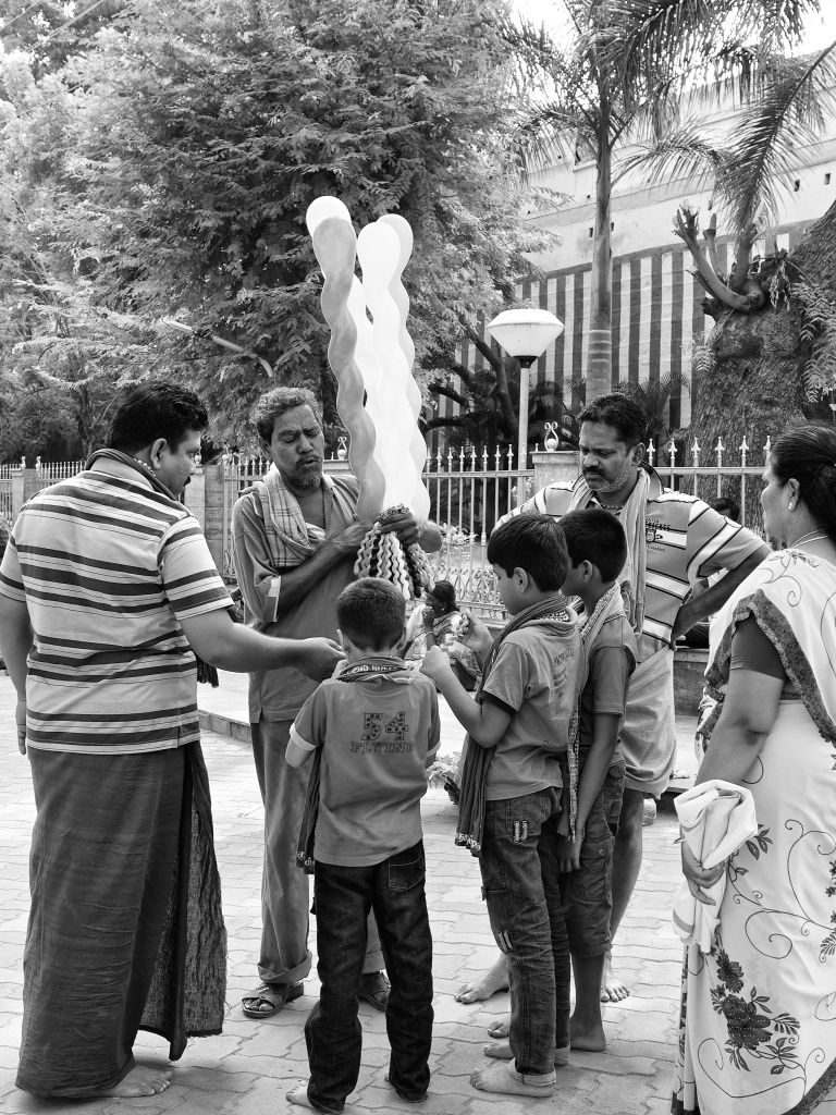 A balloon seller, selling to kids, Madurai, Tamil Nadu, India
