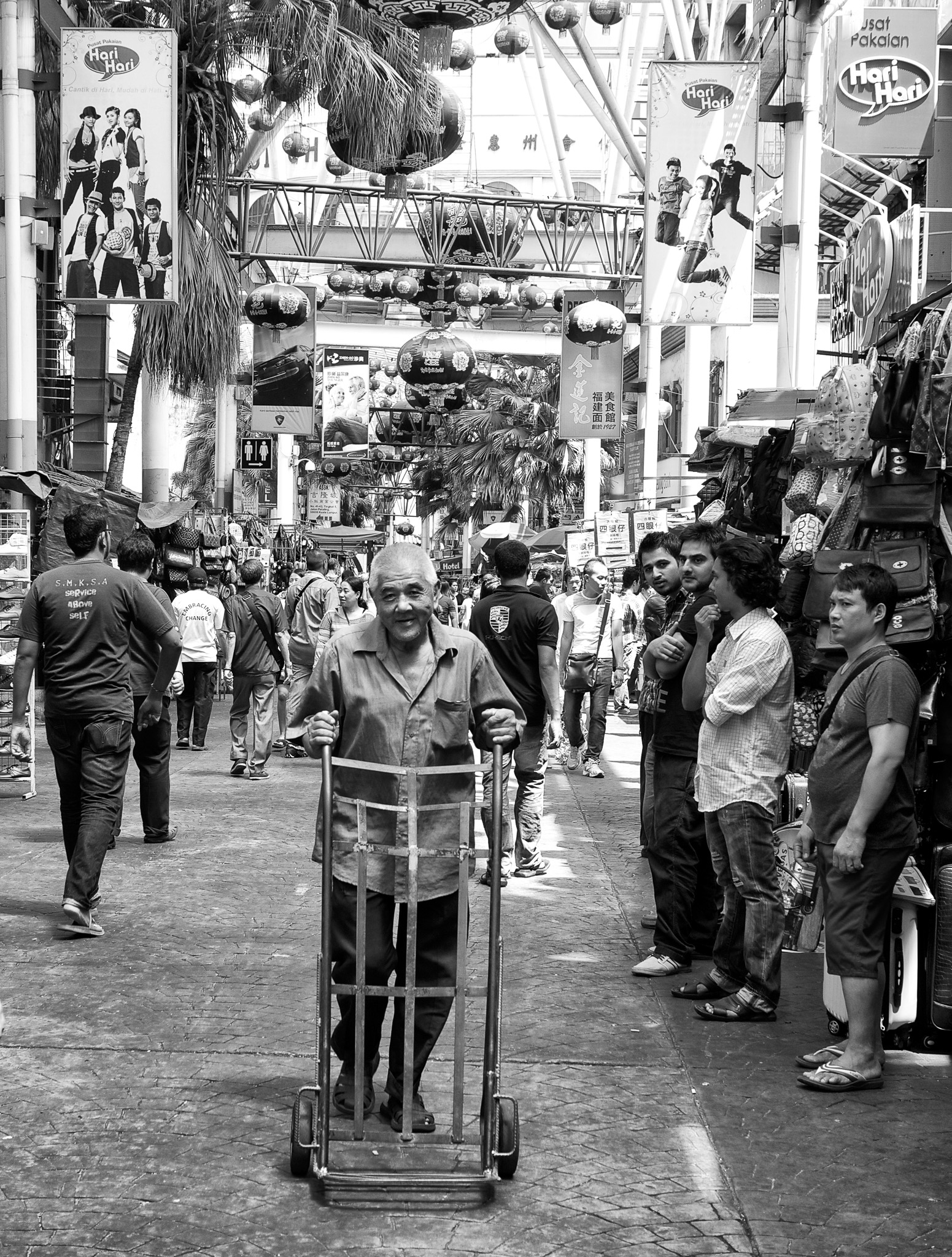 An old delivery man on the way with his trolley, Petaling Street, Kuala Lumpur, Malaysia