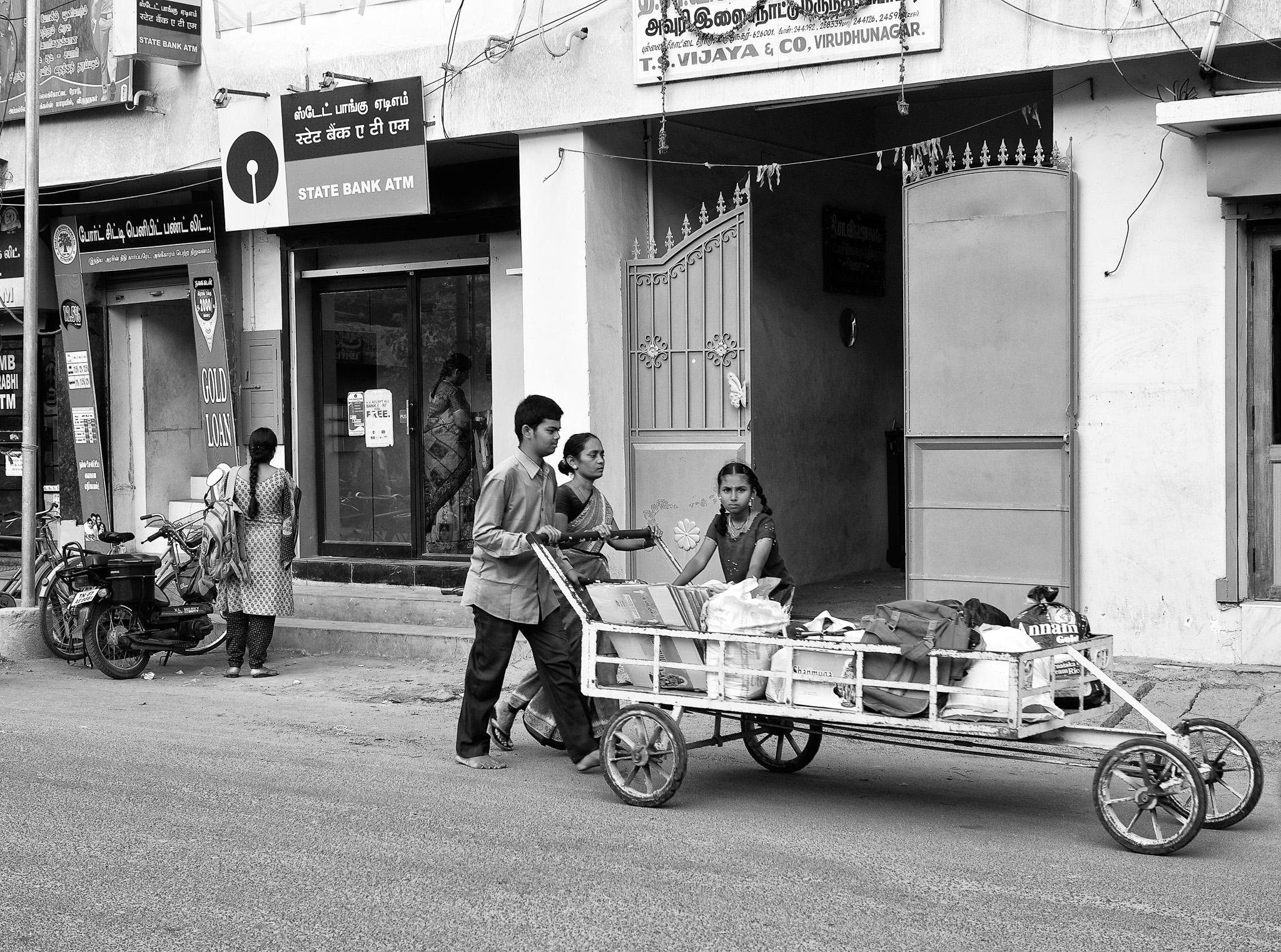 A family moving their goods in a push cart, Virudhunagar, Tamil Nadu, India