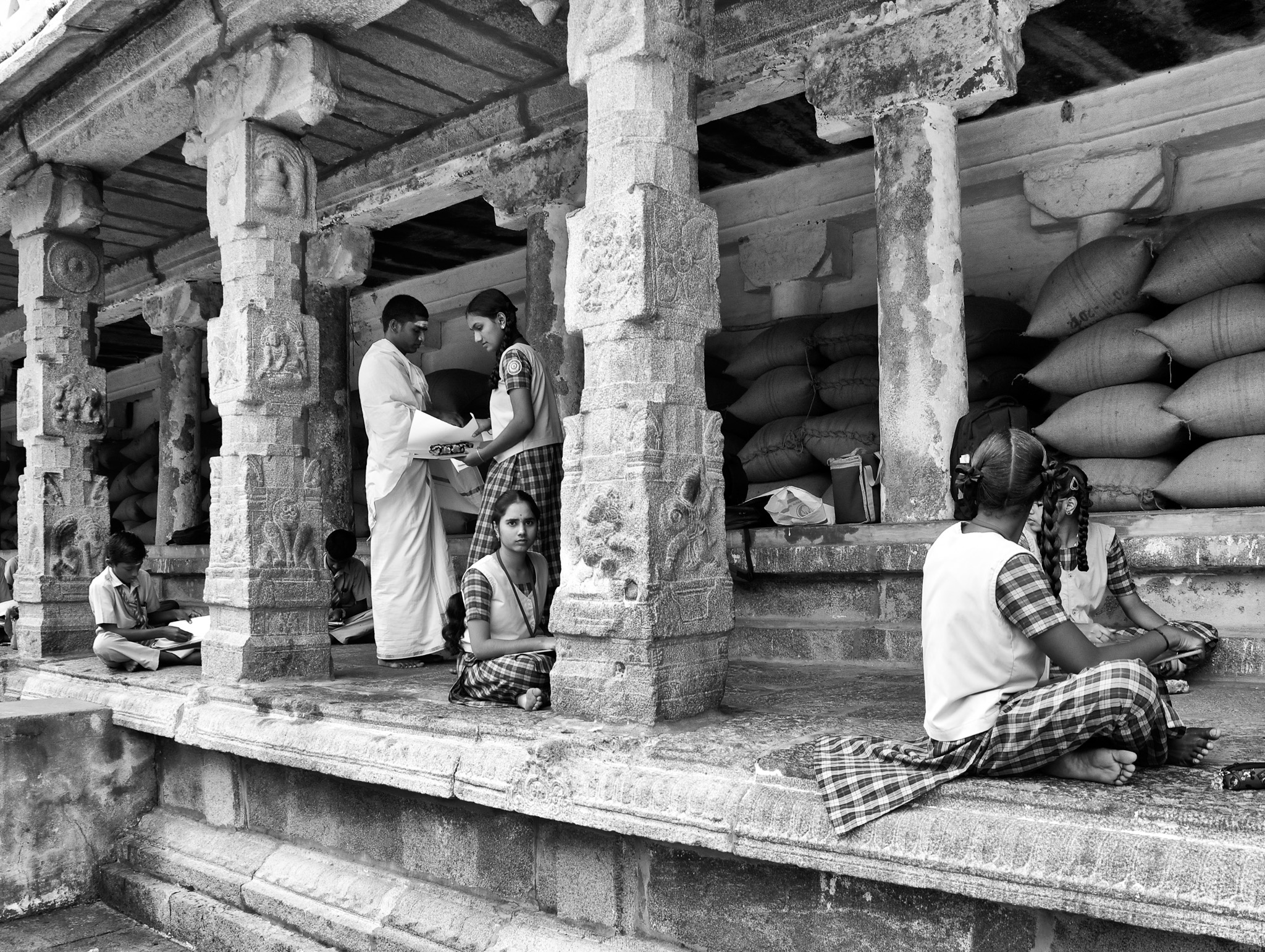 Students seated behind pillars of the Arunachalesvara Temple  for an essay competition, Tiruvannamalai, Tamil Nadu, India