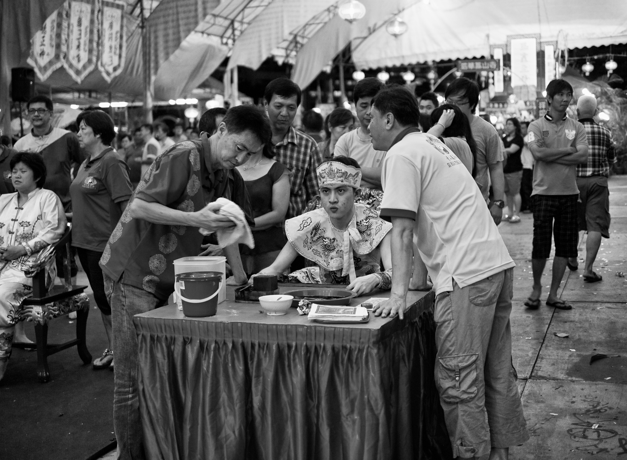 People seeking counsel from Taoist priest who is in trance as Medium. Hougang, Singapore