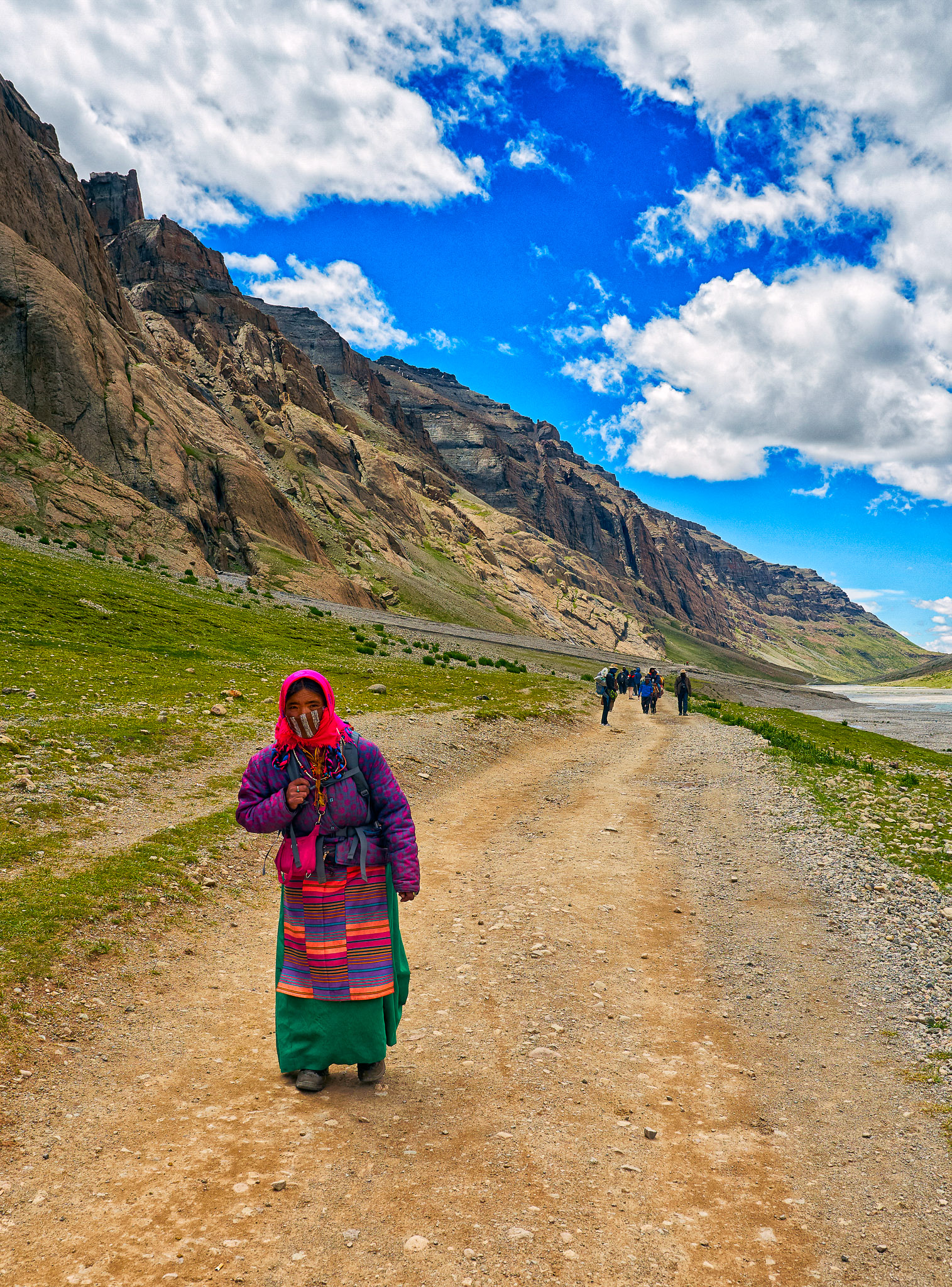A Sherpa woman carrying a bag for the trekkers, Mount Kailash, Tibet