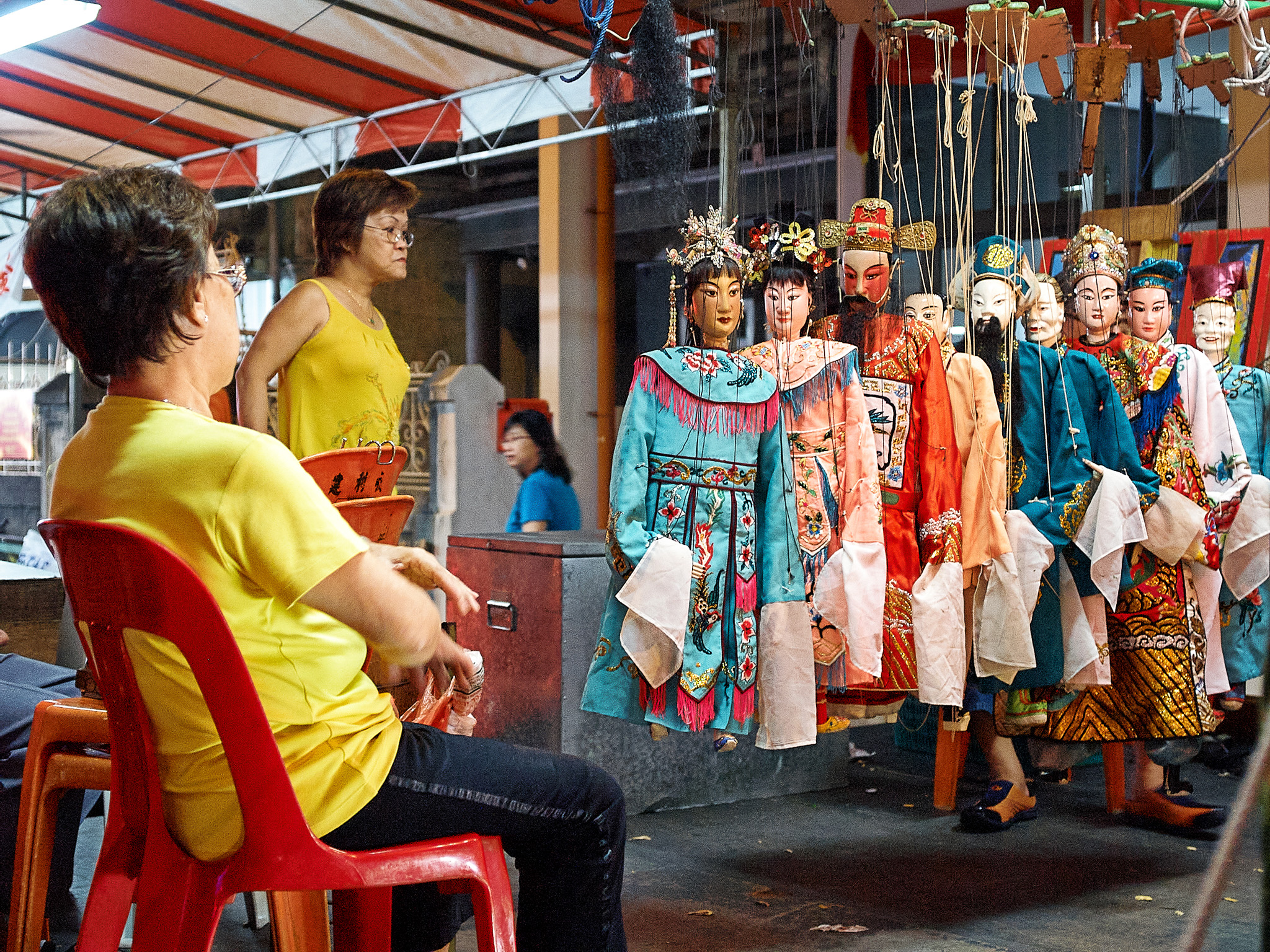Women puppeteers with their puppets, taking a break, Serangoon Road, Singapore