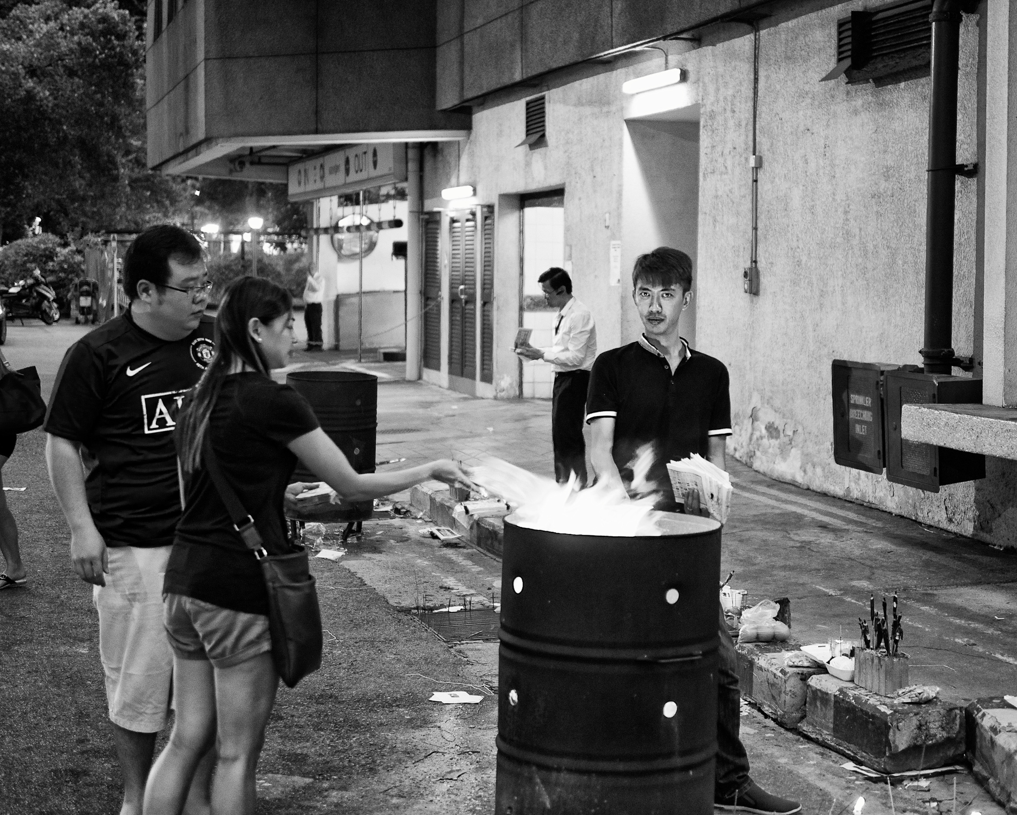 People are burning joss papers to celebrate the Hungry Ghost Festival. Jalan Sultan, Singapore