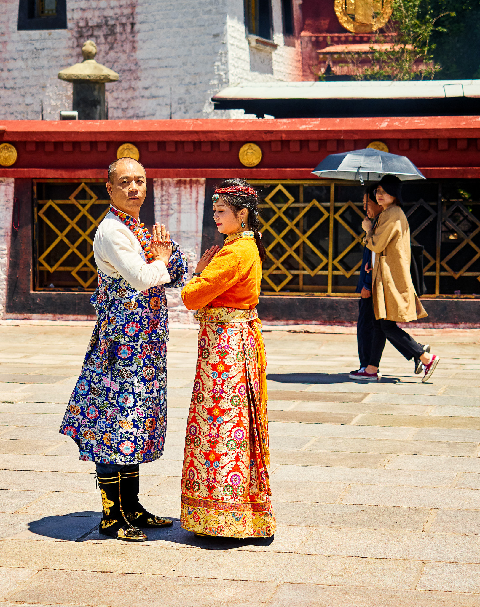 A couple having their photo shoot in front of the Jokhang Temple, Lhasa, Tibet,
