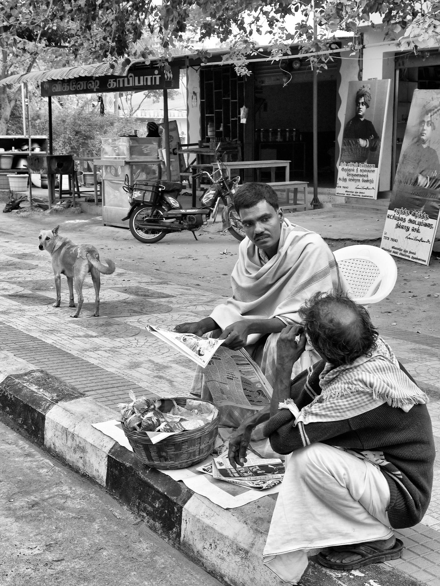 A street vendor, selling jaggery, in conversation, Tiruvannamalai, Tamil Nadu, India