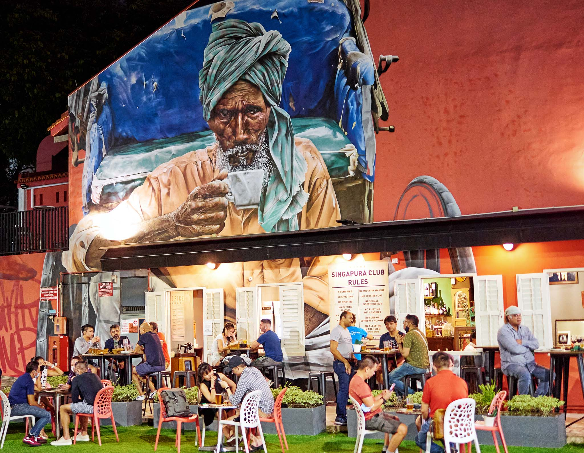 Mural of a rickshaw man in the background while patrons dining in a Bistro, Clive Street, Little India, Singapore