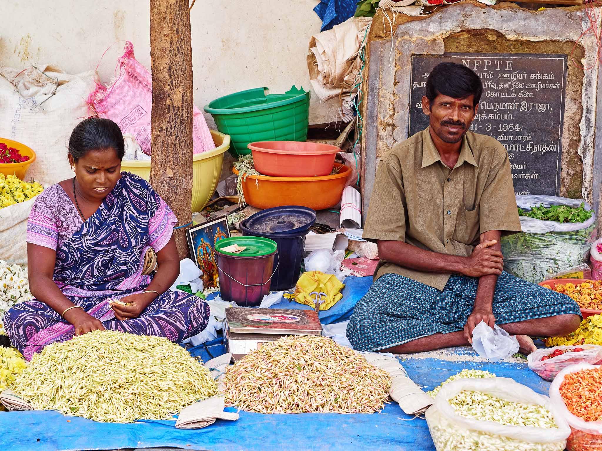 A florist couple at work in their roadside flower shop, Virudhunagar, Tamil Nadu, India