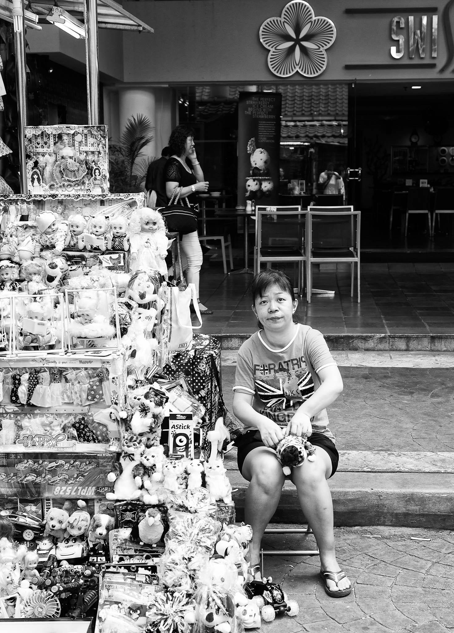 A toy shop keeper at Petaling Street, Kuala Lumpur, Malaysia