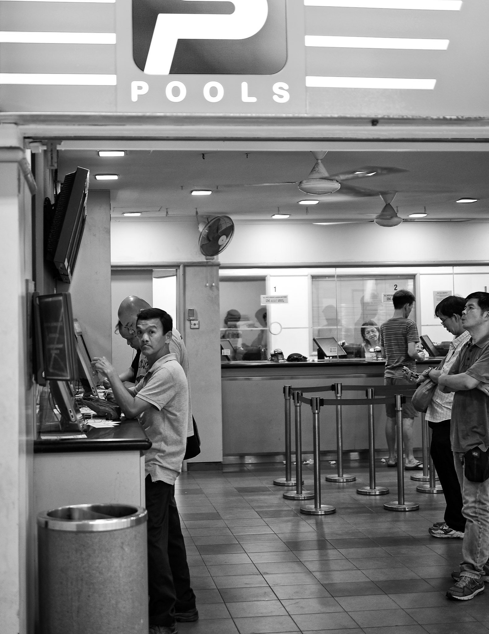 People looking at the lottery results in a lottery outlet, Bugis, Singapore