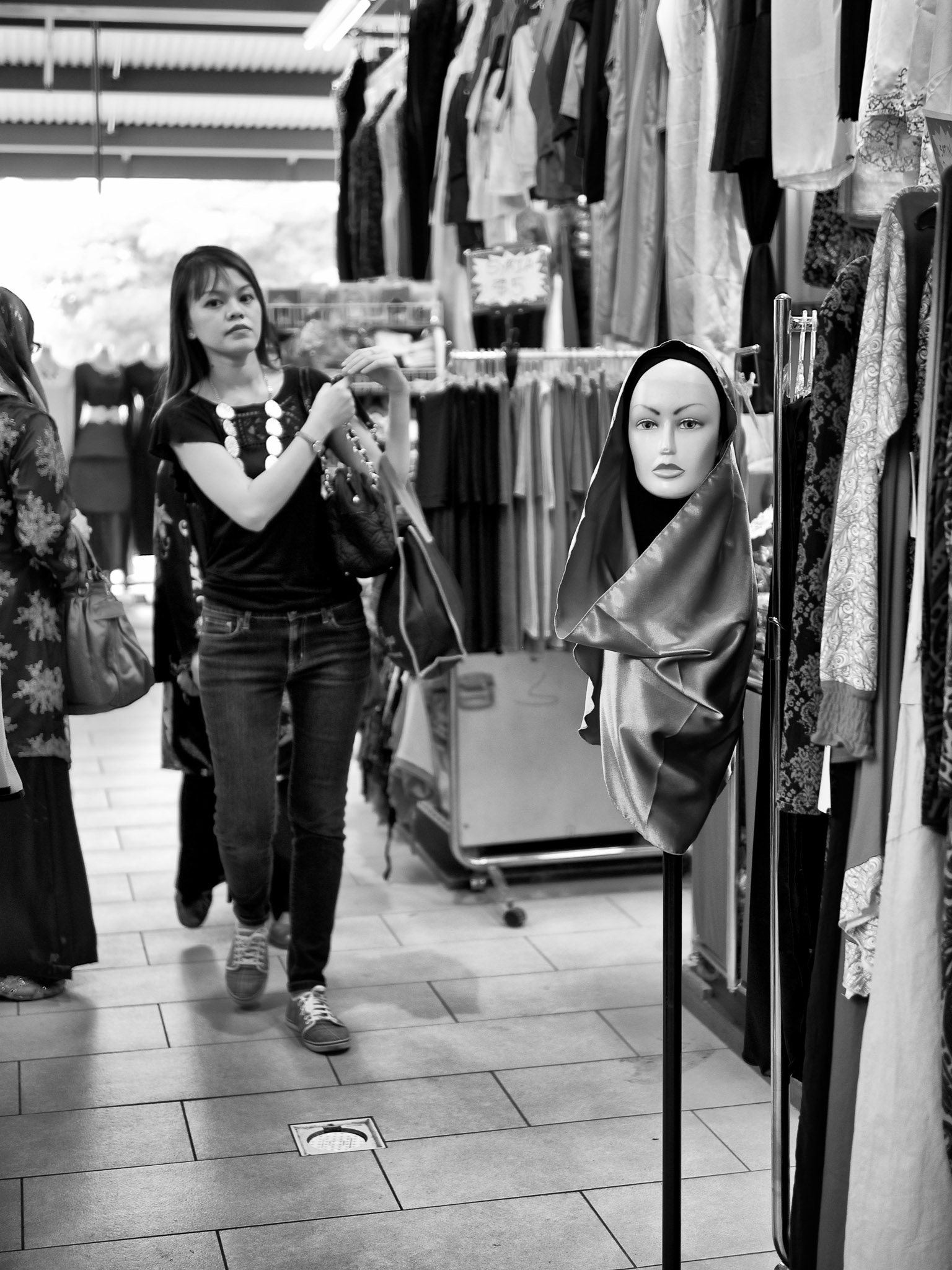 A mannequin face in the shopping corridor, Geylang Serai Market, Singapore
