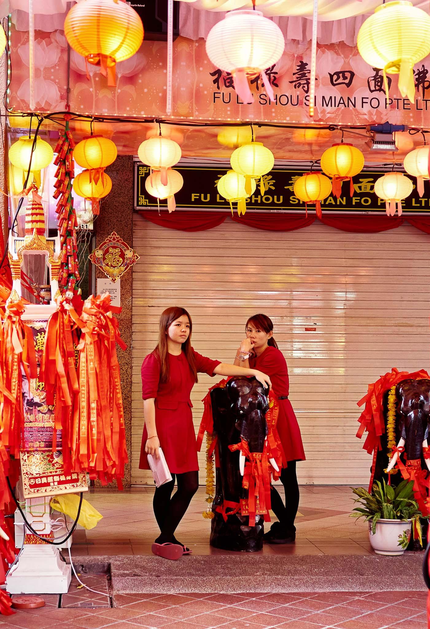 Two sales women amidst the lantern festival decorations, Bugis, Singapore
